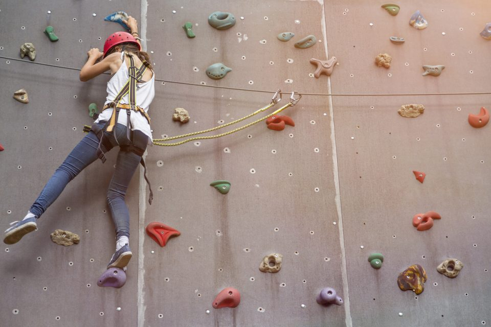 girl on a free climbing wall