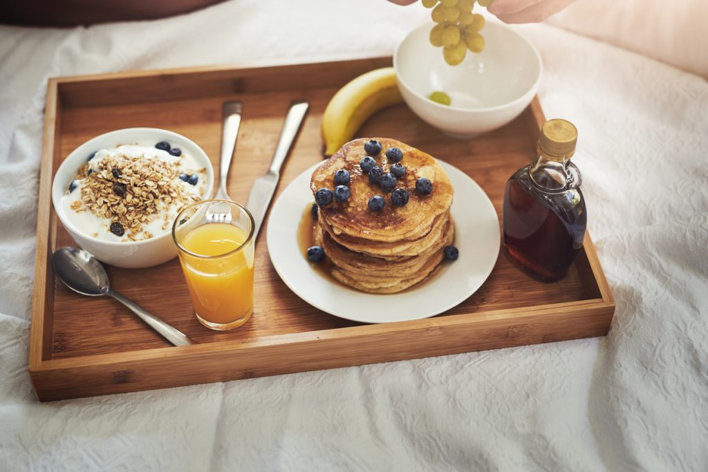 Enjoying breakfast in bed at home