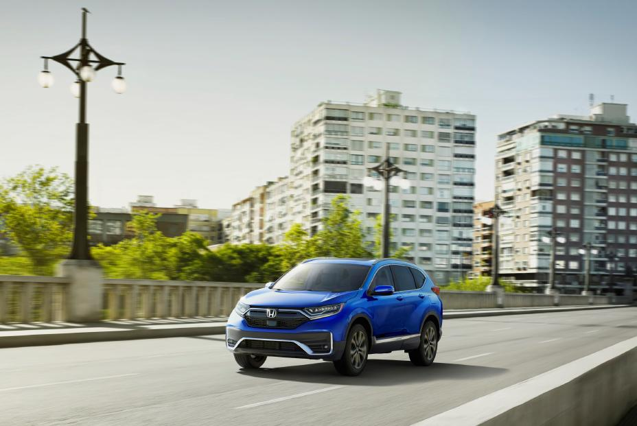 2020 Honda CR-V in blue driving along a city street